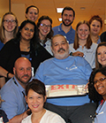Scott Fisher surrounded by his Marianjoy Therapy Team.