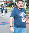After rehab for a progressive stroke, Hieu Nguyen completes a 5k race.